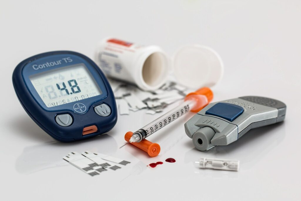 Diabetes monitoring and an insulin syringe