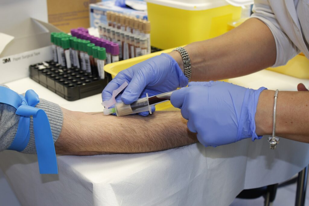 A doctor taking a blood sample
