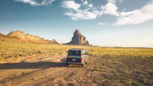 Driving across the desert in a car