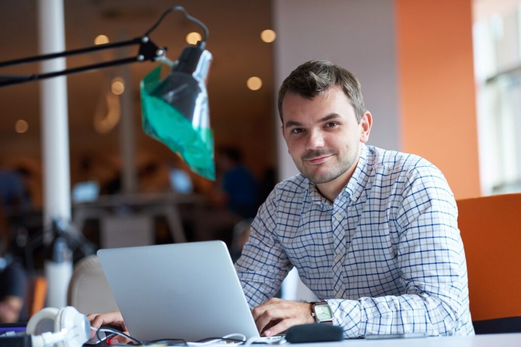 An entrepreneur working on a laptop