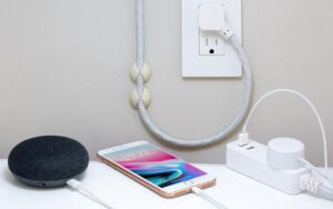 An iPhone and various charging devices