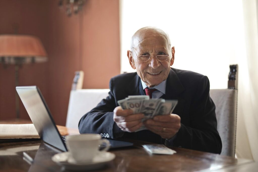 A pensioner holding some money
