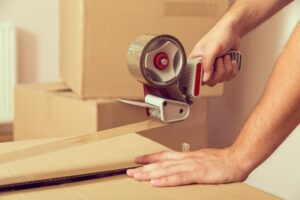 Sealing packing boxes with tape