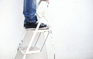 Standing on a pair of ladders