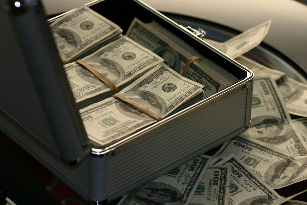 A box overflowing with dollars