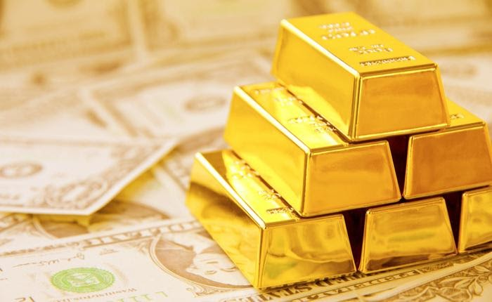 A stack of gold bars and dollar bills