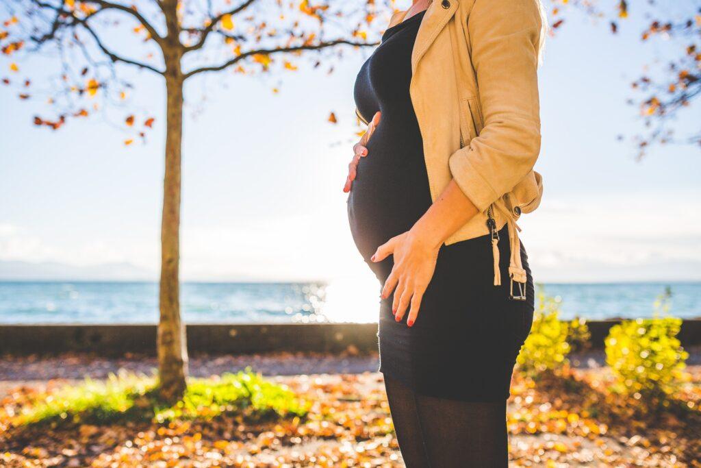 A pregnant woman in Autumn