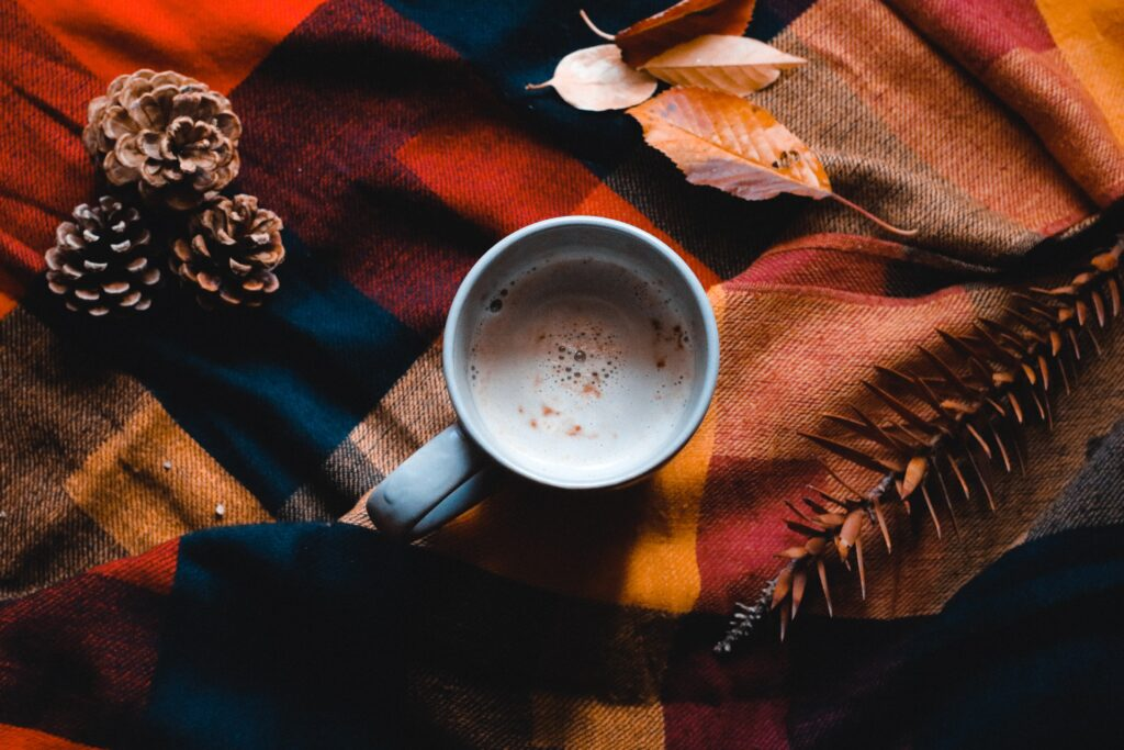 A cup of coffee and fall decorations