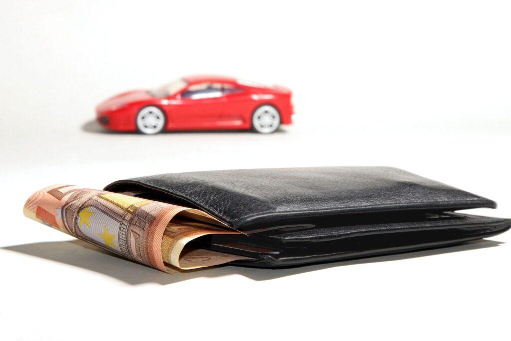 A wallet and a car - a loans concept