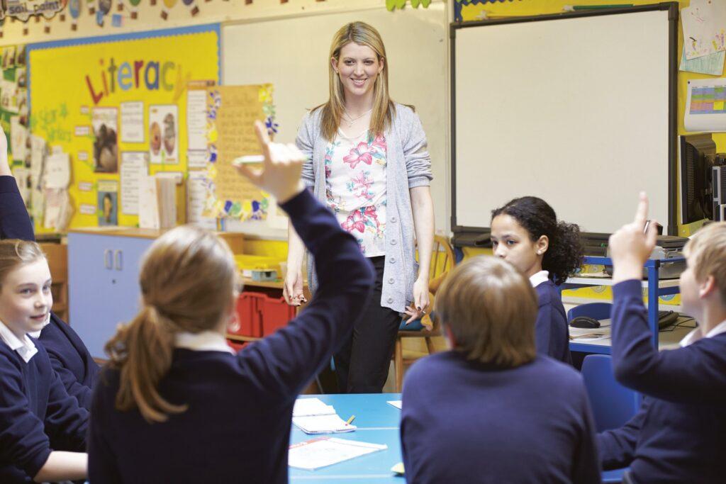 A teacher teaching a class of children
