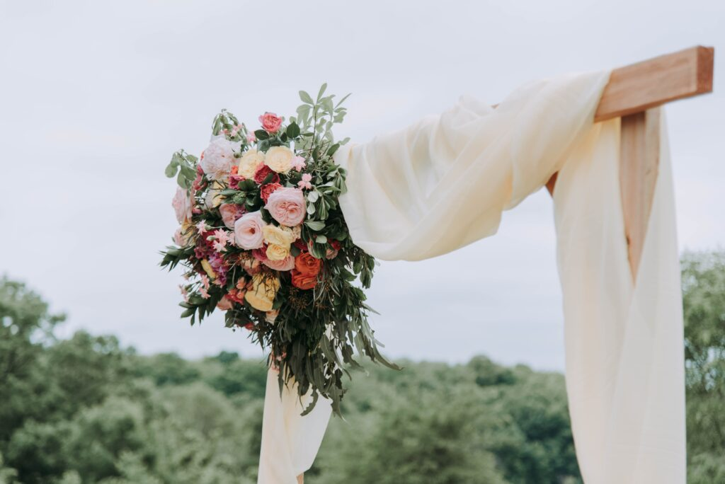 A wedding bouquet carefully arranged on a wooden post