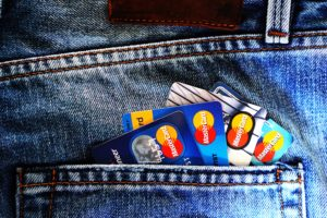 Mastercard credit cards in a jeans pocket