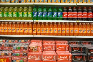 Drinks stacked on supermarket shelves