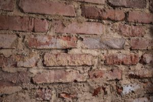 A damaged brick wall