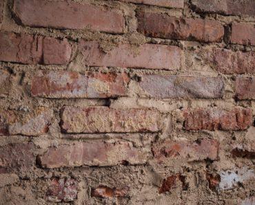 A damaged brick wall