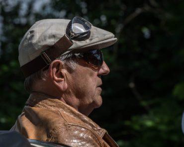 A retired man driving a sports car
