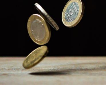 Falling coins - debt concept