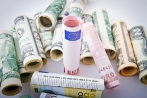 Use a currency exchange broker