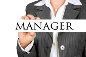 A businesswoman holdinag a manager label