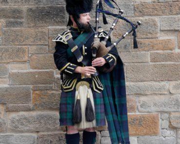 A bag piper in Scotland