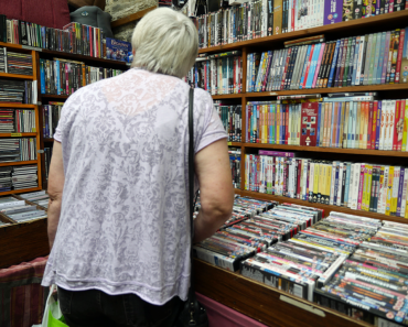 Shopping for used DVD's at a market stall