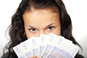 Lady with £20 banknotes