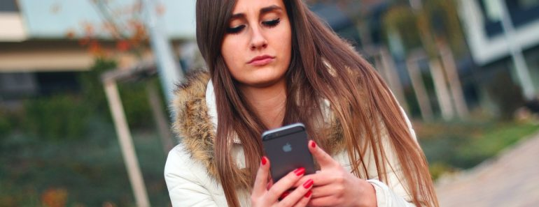 Young woman using an iPhone