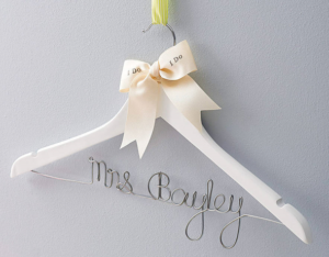 A personalised wedding gown hanger