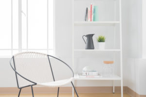 Modern chair and shelves in minimilist interior design