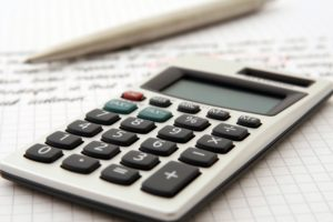 Preparing a tax return with a pen and calculator