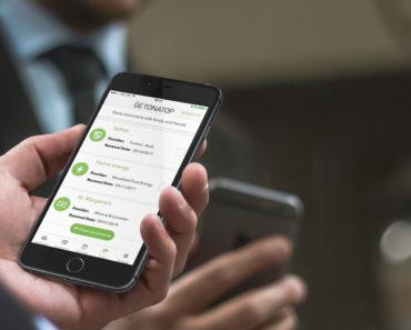 Using Getonatop finance app on a mobile phone