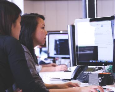 Women working on a desktop PC