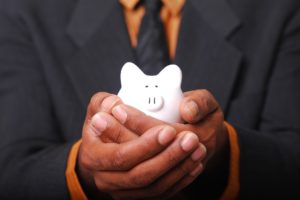 Holding a small piggy bank