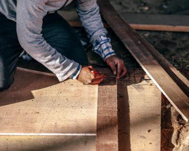 A carpenter working wood