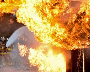 fireman fighting house fire