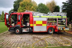A fire engine in a rural location