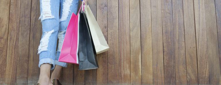 Closeup of woman holding shopping bags