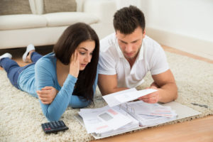 A couple prepare their tax returns
