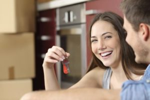 Young couple with keys to rented property