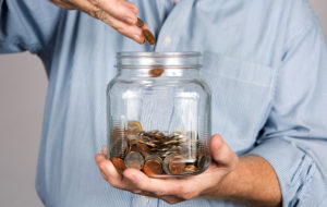 Saving coins in a large jar