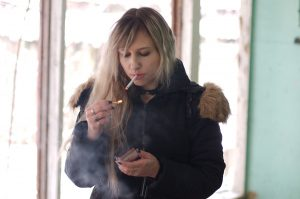 A young person smoking