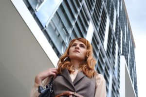 A business woman walking in a city centre