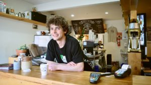 A happy young man working