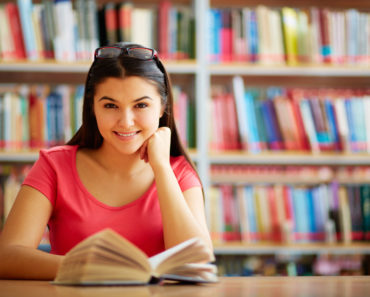 Cute student with open book