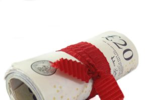 £20 notes tied in a roll