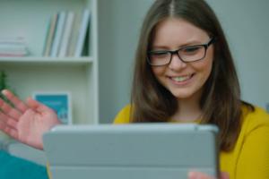 Smiling using a laptop