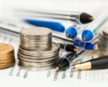 Coins and pens for financial literacy