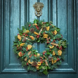 A Christmas wreath on a front door