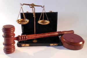 Scales of justice and a legal gavel
