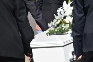 Carrying a coffin at a funeral